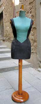 Dressmaker's dummy, black and green, with wood base
