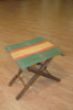 Pliable stool in wood and cloth