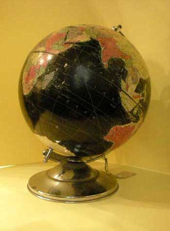 Black globe, with metal base