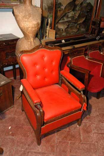Walnut armchair, with red leather and drawer