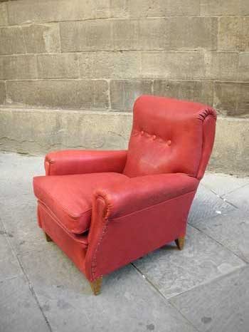 Model of Frau armchair, in red leather